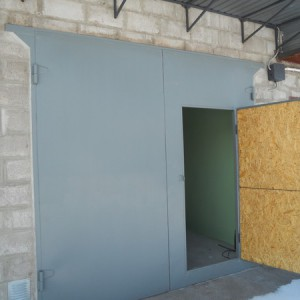 Отделываем утеплителем ворота гаража